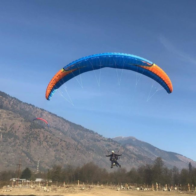 Experience trekking to glacial Rani sui lake and Paragliding from it near Manali